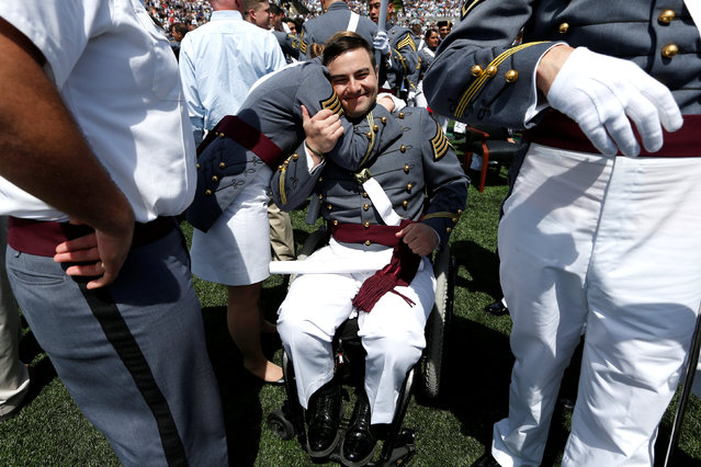 """Graduating Cadet Christopher """"Lars"""" Lofgren (C) who was injured in a training activity while a student and is wheelchair bound, is embraced by a fellow graduate of the United States Military Academy after the conclusion of commencement ceremonies in West Point, New York, U.S., May 27, 2017. (Photo by Mike Segar/Reuters)"""