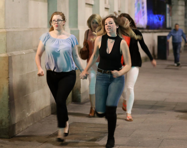 Members of the public flee the scene near London Bridge after a suspected terrorist attack on June 4, 2017 in London, England. Police responded to what they are calling terrorist attacks on London Bridge and Borough Market where at least 20 people were injured and one person was killed. (Photo by Dan Kitwood/Getty Images)