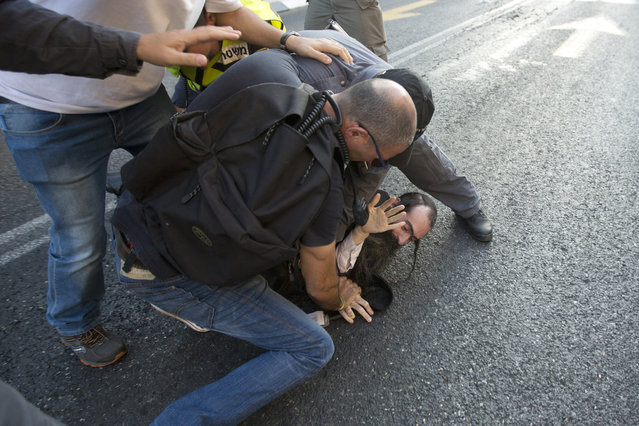 Police arrest an ultra-Orthodox Jew after he attacked people with a knife during a Gay Pride parade Thursday, July 30, 2015 in central Jerusalem. (Photo by Sebastian Scheiner/AP Photo)