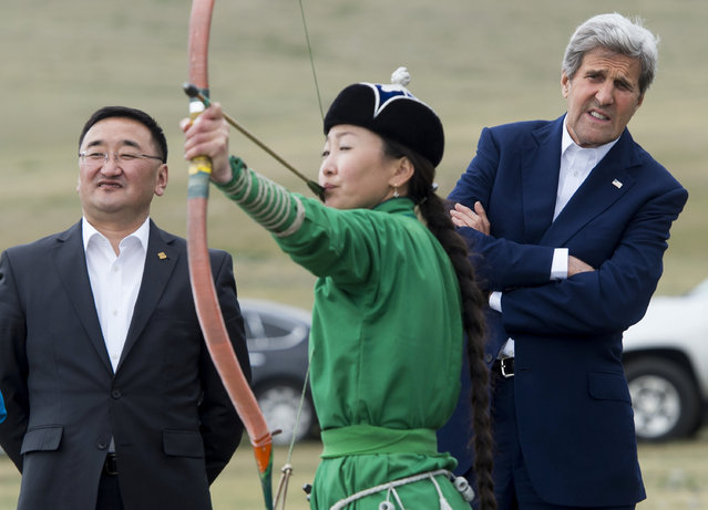 U.S. Secretary of State John Kerry and Mongolian Foreign Minister Lundeg Purevsuren watch an archer during a Naadam ceremony, a competition which traditionally includes horse racing, Mongolian wrestling and archery, in Ulan Bator, Mongolia, June 5, 2016. (Photo by Saul Loeb/Reuters)