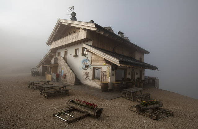 The Rifugio Averau is seen shrouded in fog near Cortina d' Ampezzo in northern Italy July 16, 2015. (Photo by Bob Strong/Reuters)