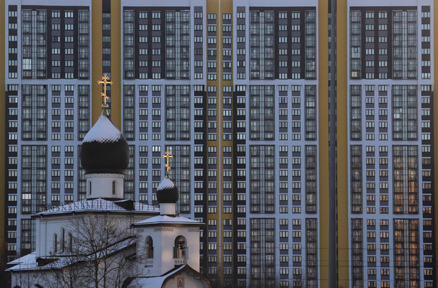 A view shows a church in front of a high-rise apartment building in Saint Petersburg, Russia on October 30, 2019. (Photo by Anton Vaganov/Reuters)