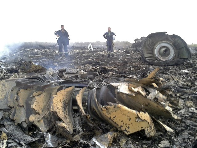 Emergencies Ministry members work at the site of a Malaysia Airlines Boeing 777 plane crash in the settlement of Grabovo in the Donetsk region, July 17, 2014. The Malaysian airliner was shot down over eastern Ukraine by pro-Russian militants on Thursday, killing all 295 people aboard, a Ukrainian interior ministry official said. (Photo by Maxim Zmeyev/Reuters)