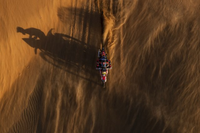 Jose Ignacio Cornejo Florino of Chile rides his Honda motorbike during stage eleven of the Dakar Rally between Shubaytah and Haradth, Saudi Arabia, Thursday, January 16, 2020. (Photo by Bernat Armangue/AP Photo)