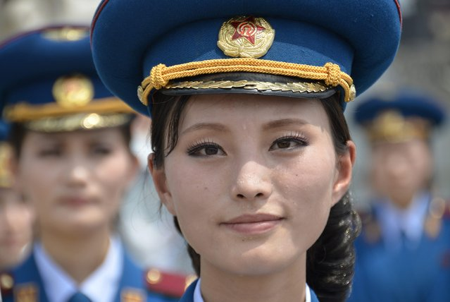 A musician from a North Korean military band looks on during the opening ceremony of a new dock at the port of Rajin July 18, 2014. The dock was jointly built with Russia after last year's completion of a railway link to North Korea, holding out the prospect of increased trade for the reclusive nation with its biggest neighbours after years of international sanctions. (Photo by Yuri Maltsev/Reuters)