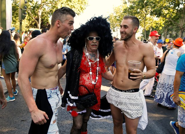 Revellers pose for a picture during a gay pride parade in downtown Madrid, Spain, July 2, 2016. (Photo by Andrea Comas/Reuters)