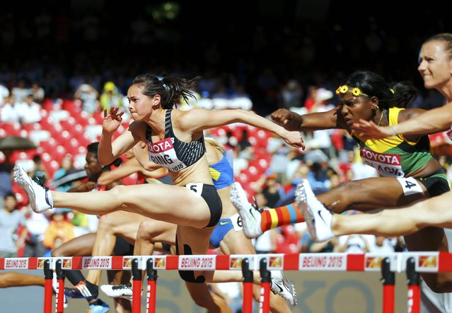 Portia Bing of New Zealand (C) and Salcia Slack of Jamaica (2nd R) compete in the 100m hurdles event of the women's heptathlon during the 15th IAAF World Championships at the National Stadium in Beijing, China August 22, 2015. (Photo by Kai Pfaffenbach/Reuters)