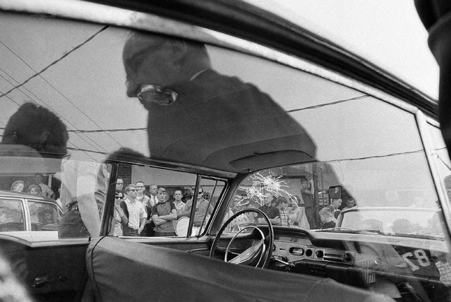 George Lincoln Rockwell was killed by a sniper as he sat in this automobile in a parking lot at an Arlington Shopping Center, August 25, 1967. Police said the fatal bullet came from the roof of the shopping center. (Photo by AP Photo)