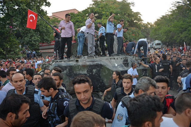 People gather on the top of a Turkish military tank July 16, 2016 in Ankara, Turkey. (Photo by Gokhan Sahin/Getty Images)