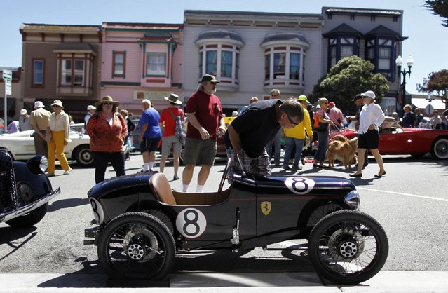 A Palazzolo, a rendition of a 1920-30s cycle car, is displayed during the Little Car Show in Pacific Grove, California, August 13, 2014. The event, which showcases small cars with up to 1,601cc engines as well as electric cars, is held during the Pebble Beach Automotive Week which culminates with the Concours d'Elegance. (Photo by Michael Fiala/Reuters)