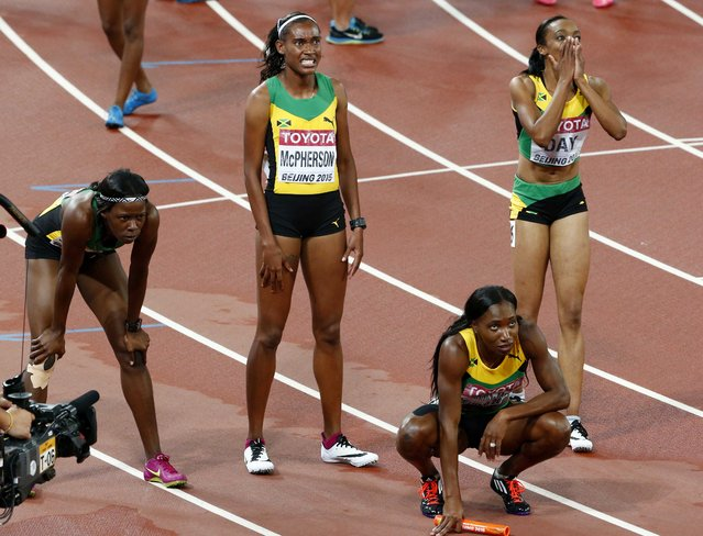 The Jamaica team looks at the scoreboard after the women's 4 x 400 metres relay final at the 15th IAAF Championships at the National Stadium in Beijing, China August 30, 2015. (Photo by David Gray/Reuters)