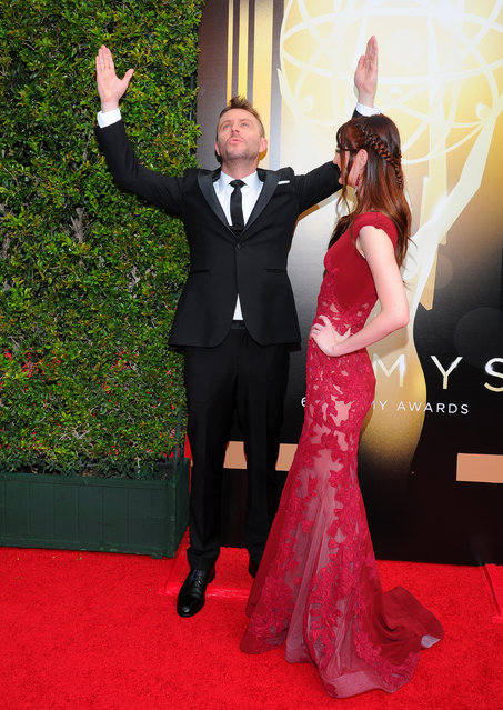 Chris Hardwick, left, and Lydia Hearst arrive at the Television Academy's Creative Arts Emmy Awards at Microsoft Theater on Saturday, September 12, 2015, in Los Angeles. (Photo by Vince Bucci/Invision for the Television Academy/AP Images)