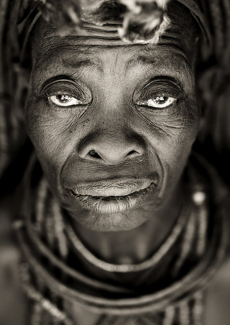 """Old Himba woman face – Angola. Old Himba woman in Angola, not the kind of ones you see in Namibia going to supermarket, and buying beers, but living in remote place, in south Angola, far from modern world, keeping their traditions strongly"". (Eric Lafforgue)"