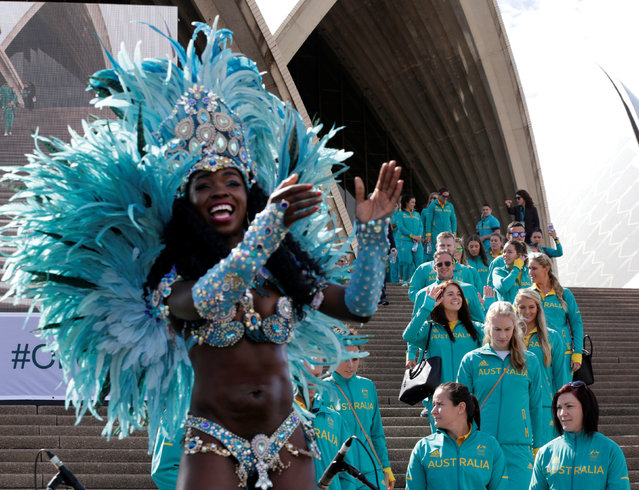 A Brazilian dancer performs on stage during an official welcome home for Australia's Olympic athletes (R) upon their return from Rio at the Sydney Opera House in Australia, August 29, 2016. (Photo by Jason Reed/Reuters)