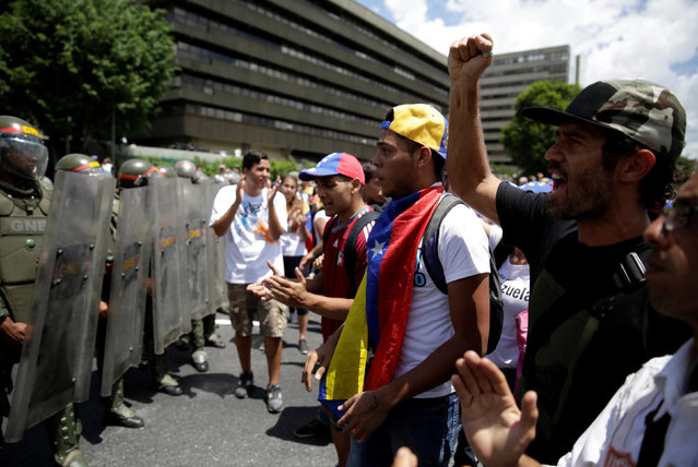 Protesters shout slogans near of riot police during a rally to demand a referendum to remove Venezuela's President Nicolas Maduro in Caracas, Venezuela, September 1, 2016. (Photo by Marco Bello/Reuters)