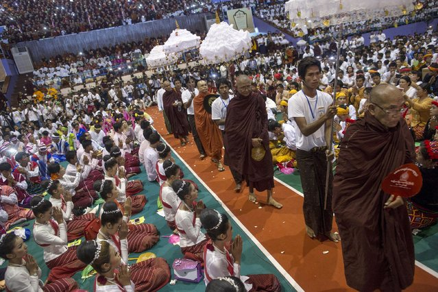 Leaders of radical Buddhist group Ma Ba Tha arrive during a celebration of the recent establishment of four controversial bills decried by rights groups as aimed at discriminating against the country's Muslim minority, at a rally in a stadium at Yangon October 4, 2015. (Photo by Soe Zeya Tun/Reuters)