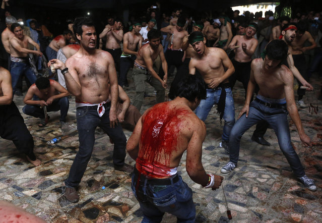 Afghan Shi'ite Muslim men flagellate themselves during a Muharram procession in Kabul October 31, 2014. (Photo by Omar Sobhani/Reuters)