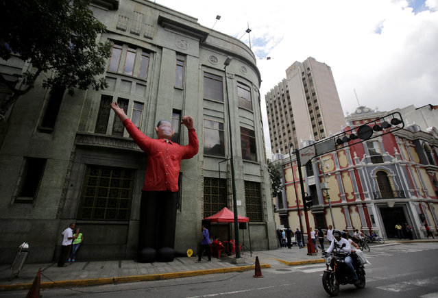 A giant inflatable figure of Venezuela's late president Hugo Chavez stands on a sidewalk in Caracas, Venezuela September 8, 2016. (Photo by Henry Romero/Reuters)