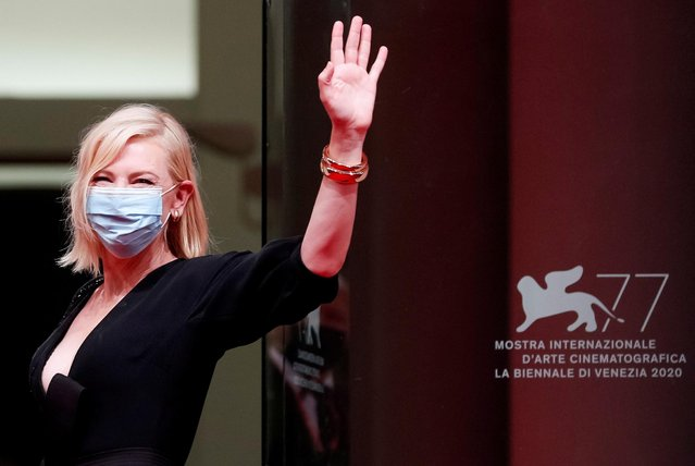 """Jury President Cate Blanchett wearing a protective mask waves during the screening of the film """"Wife of a Spyt"""" at the 77th Venice Film Festival on September 9, 2020 in Venice, Italy. (Photo by Guglielmo Mangiapane/Reuters)"""