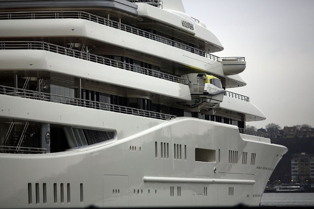 The Eclipse, reported to be the largest private yacht in the world, is viewed docked at a pier in New York on February 19, 2013 in New York City. The boat, which measures 557ft in length and is estimated to cost 1.5 billion US dollars, is owned by Russian billionaire Roman Abramovich and arrived into New York on Wednesday.  (Photo by Spencer Platt)