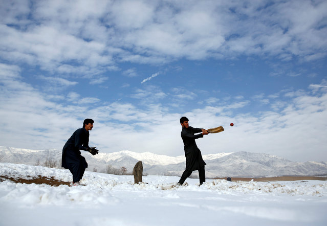 Afghan men play cricket on a field covered in snow on the outskirts of Kabul, Afghanistan December 16, 2017. (Photo by Mohammad Ismail/Reuters)