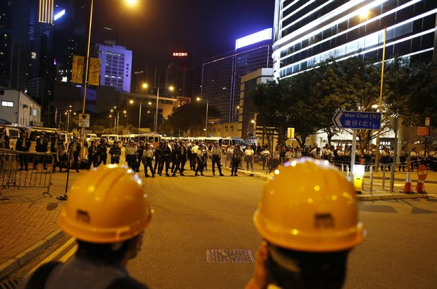 Policemen stand guard outside the chief executive office during a pro-democracy rally in Hong Kong, November 30, 2014. (Photo by Bobby Yip/Reuters)