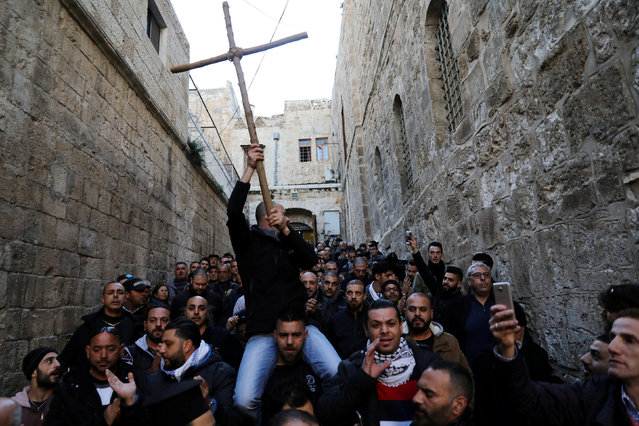 Worshippers shout slogans during a protest near the closed entrance to the Church of the Holy Sepulchre in Jerusalem's Old City, February 27, 2018. (Photo by Ammar Awad/Reuters)