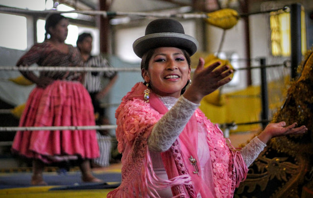 """Bolivian cholitas wrestling. Think WWF, but in traditional Bolivian dress"". (Photo by Daniel Allcock/The Guardian)"