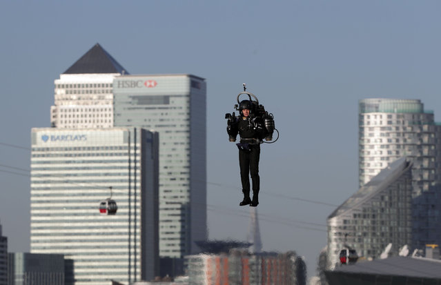 David Mayman pilots the JB-10 Jetpack over the Royal Victoria Docks in east London on its maiden flight in the UK on October 5, 2016. (Photo by Yui Mok/PA Wire)