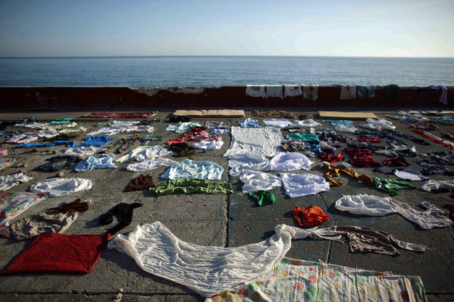 Clothes are put to dry at the sea front after the passage of Hurricane Matthew in Baracoa, Cuba October 7, 2016. (Photo by Alexandre Meneghini/Reuters)