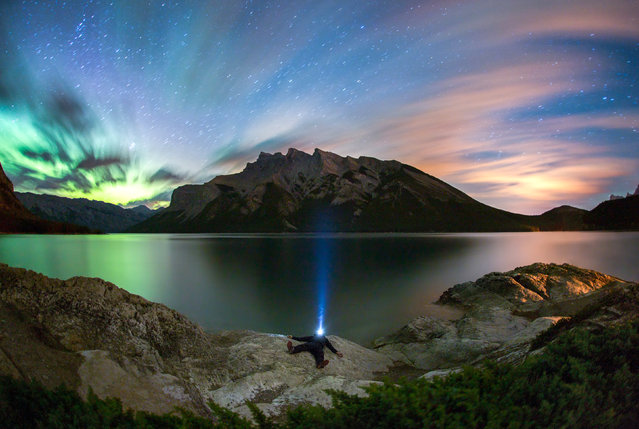 A photographer has shot this series of scenic selfies – scaling freezing mountain tops to snap himself in front of stunning scenery. Paul Zizkas breath-taking work features himself in front of beautiful backdrops such as shimmering lakes, snowy mountains and vibrant auroras. He has travelled to a number of different locations worldwide including Canada, New Zealand, Niue the South Pacific and French Polynesia. (Photo by Paul Zizkas/Caters News)