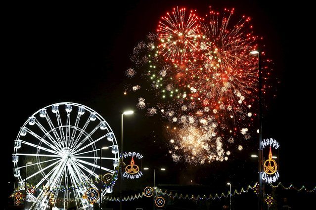 Fireworks explode near the Wheel of Light during Diwali celebrations in Leicester, Britain November 11, 2015. (Photo by Darren Staples/Reuters)