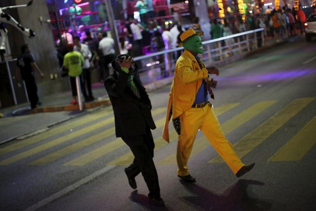 "Men dressed as ""The Mask"" walk on a street in Cancun, October 12, 2015. (Photo by Edgard Garrido/Reuters)"