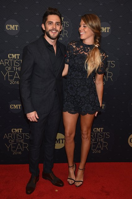 Singer-songwriter Thomas Rhett (L) and Lauren Gregory (R) arrive on the red carpet at CMT Artists of the Year 2016 on October 19, 2016 in Nashville, Tennessee. (Photo by John Shearer/Getty Images for CMT)