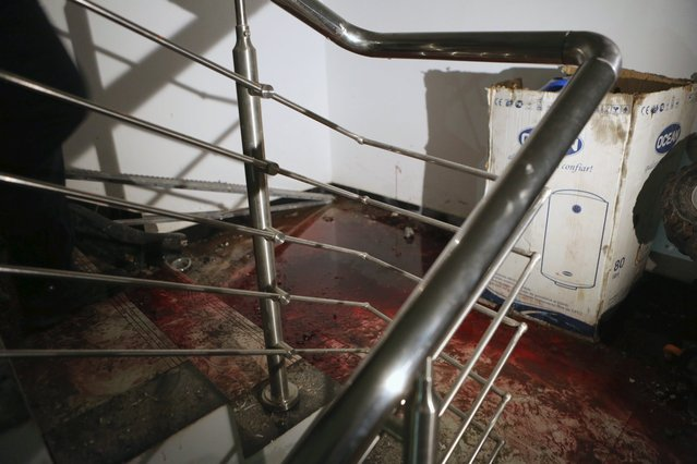 Blood is seen at a staircase of the Radisson hotel in Bamako, Mali, November 20, 2015. (Photo by Joe Penney/Reuters)
