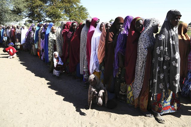 Women who have fled violence in Nigeria queue for food at a refugee welcoming center in Ngouboua, Chad, January 19, 2015. (Photo by Emmanuel Braun/Reuters)