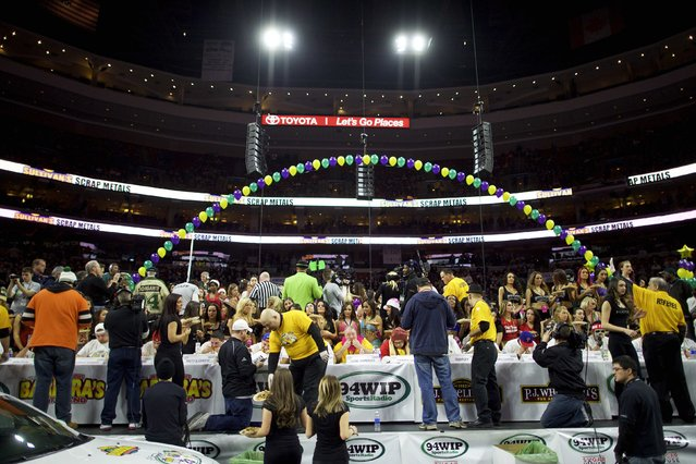 Contestants participate in the 23rd annual Wing Bowl at the Wells Fargo Center in Philadelphia, Pennsylvania January 30, 2015. (Photo by Mark Makela/Reuters)