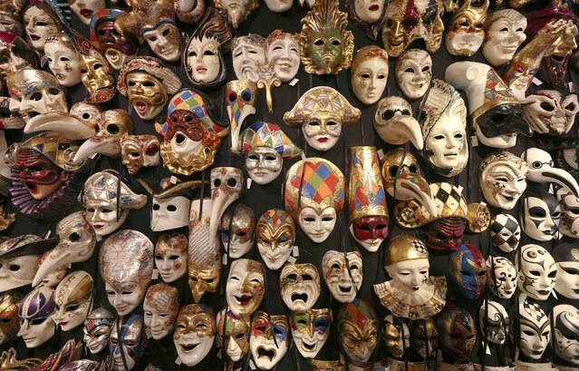 "Carnival masks hang on a wall in the ""Ca' del Sol"" artisan shop near St. Mark's square during the first day of carnival in Venice February 1, 2015. (Photo by Stefano Rellandini/Reuters)"