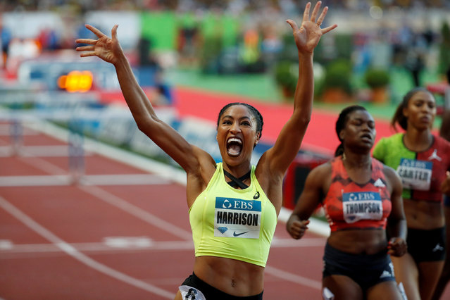 """Queen Harrison of the US celebrates after victory in the women' s 100 metres hurdles during the IAAF Diamond League athletics """"Herculis"""" meeting at The Stade Louis II Stadium in Monaco on July 20, 2018. (Photo by Eric Gaillard/Reuters)"""