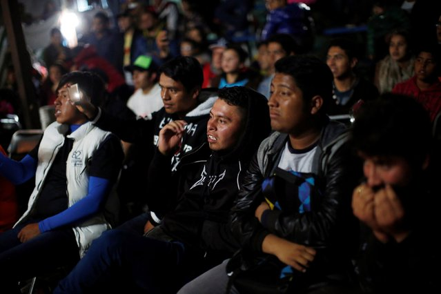 People react as they look at an extreme wrestling fight at a temporary wrestling ring inside a car wash in Tulancingo Hidalgo, Mexico October 8, 2016. (Photo by Carlos Jasso/Reuters)