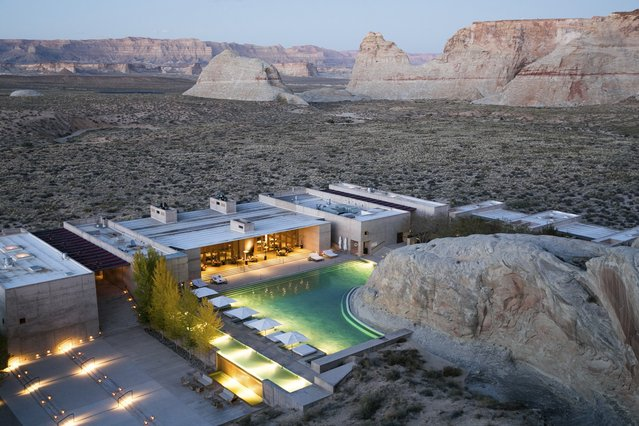 "World's Greatest Swimming Pools: This uber high-end Utah desert resort is proving a big hit with privacy-seeking celebrities. The five-star luxury Amangiri retreat – rumored to be currently hosting A-lister Kourtney Kardashian and her beau Younes Bendjima – is tucked within the luminous canyons of the American Southwest, in a protected valley at Canyon Point close to Arizona's Antelope Canyon. The exclusive hideaway, which was also the honeymoon destination for glamor model Emily Ratajkowski and new husband, has also hosted high-profile actors Sam and Lara Worthington, and reality TV star Kyle Richards. The unique venue is said to offer both ""adrenaline-fueled adventure experiences and a peaceful retreat"". Suites and private paradise villas are immersed in the stunning landscape, framing the surrounding dunes, plateaus and mountain ridges. The design and layout is aimed to ""embrace the area's raw aesthetic"" including its desert-view spa and dining room (From $1,550). (Photo by Aman / Splash News and Pictures)"