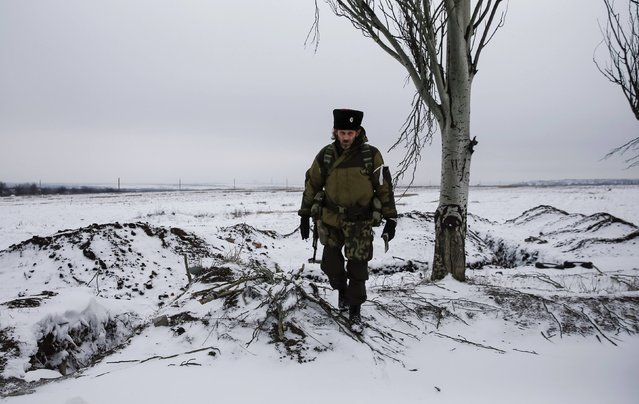 A pro-Russian separatist looks on in the outskirts of Vuhlehirsk, eastern Ukraine February 10, 2015. (Photo by Maxim Shemetov/Reuters)