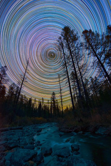 Vibrate, colorful star trails by a creek. (Photo by Evgeniy Zaytsev/Caters News)