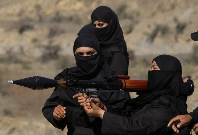 Pakistani female police commandos attend a training session in Nowshera, near Peshawar Pakistan, Wednesday, February 11, 2015. Authorities formed a Special Combat Unit after Taliban militants stormed a Peshawar school on Dec. 16, 2014 and massacred 150 children and teachers. (Photo by Mohammad Sajjad/AP Photo)