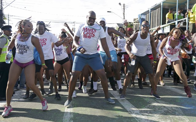 Revellers from the band Mardi Gras dance during Carnival Monday on the streets of Woodbrook, Port of Spain February 16, 2015. (Photo by Andrea De Silva/Reuters)