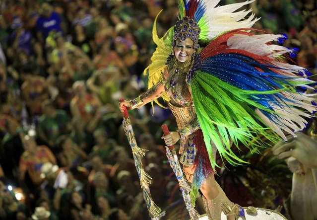 A reveler from the Beija Flor  samba school participates in the annual carnival parade in Rio de Janeiro's Sambadrome, February 17, 2015. (Photo by Sergio Moraes/Reuters)