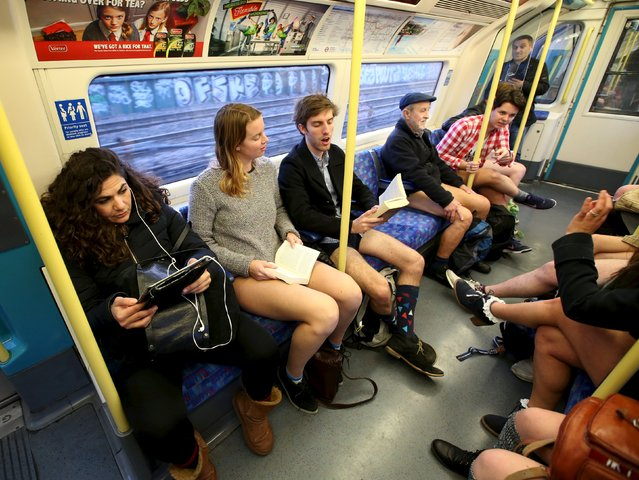 Participants in the annual No Trousers On The Tube Day ride the London Underground in London, Britain January 10, 2016. (Photo by Paul Hackett/Reuters)
