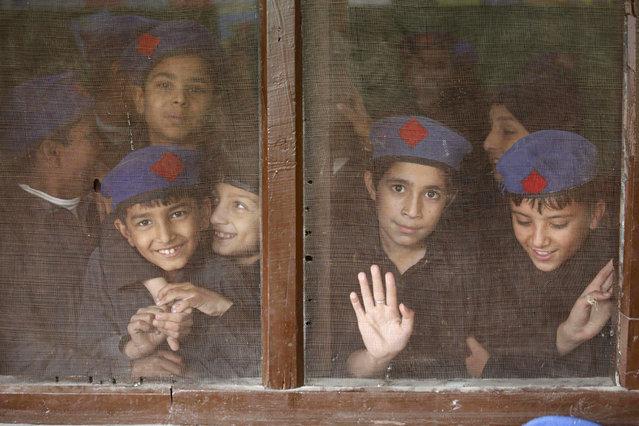 Pakistani boys attend school a day ahead of the International Student Day in Peshawar, Pakistan, 16 November 2016. International student Day is marked annually on 17 November. (Photo by Bilawal Arbab/EPA)