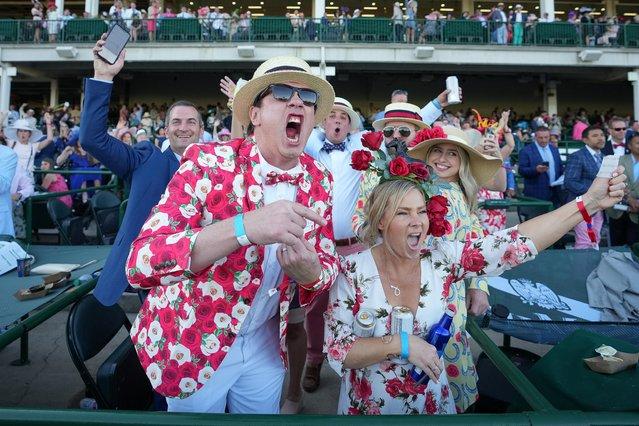 Spectators cheer after Medina Spirit, ridden by John Velazquez wins 147th Kentucky Derby at. Churchill Downs, in Louisville, Kentucky, U.S. May 1, 2021. (Photo by Bryan Woolston/Reuters)