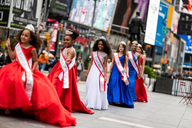 Girls pose for pictures during a beauty contest, amid the coronavirus disease (COVID-19) pandemic, at Times Square in Manhattan, New York City, U.S., May 7, 2021. (Photo by Eduardo Munoz/Reuters)